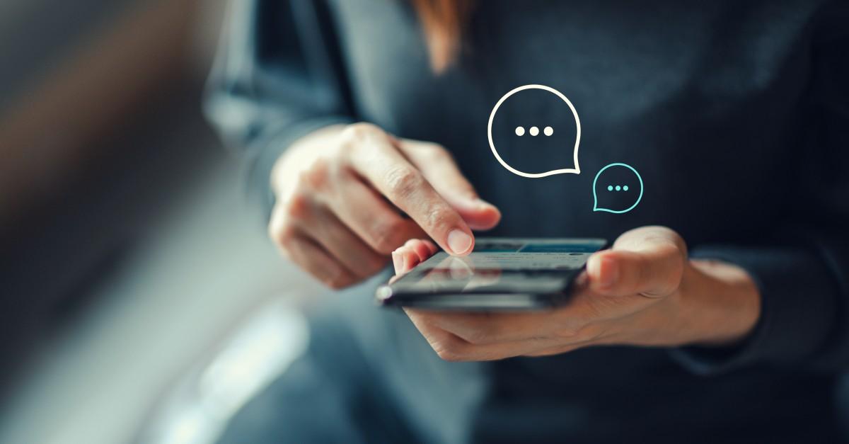 Women typing on smartphone about marketing messaging framework