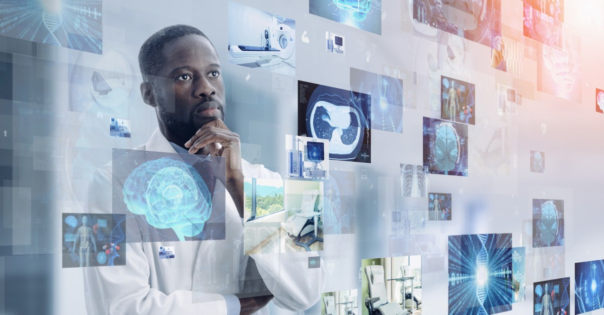 Doctor looking at healthcare reform information technology concepts