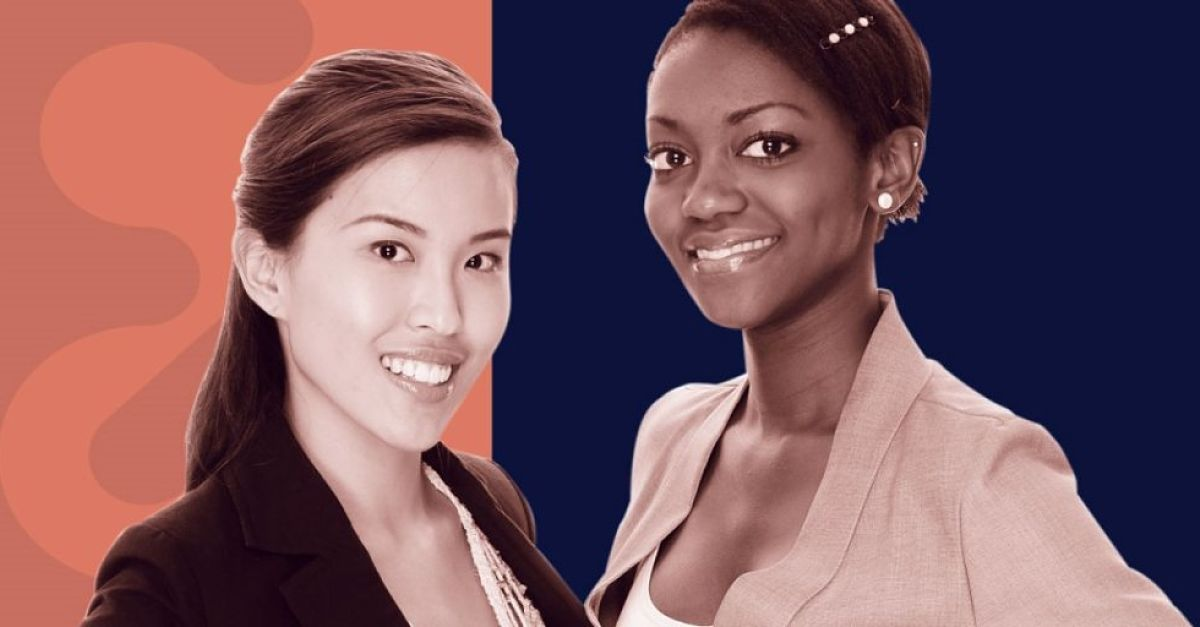 Two business women standing up